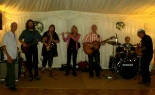 Sheer Hopody Barn Dance Band playing for a wedding ceilidh in a marqee somewhere in the depths of deepest East Devon